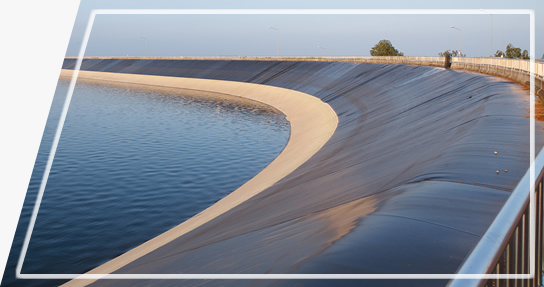 Black geomembrane is wrapped around the lank bank, and there are a lot of water in it.