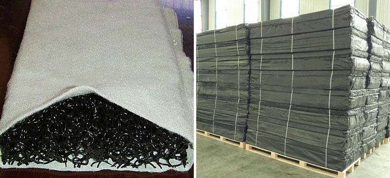 Rectangular plastic blind drains packaged with black plastic film are piled up together on wooden pallets in the factory.