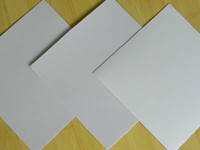 There are three pieces of white LDPE geomembrane sample lying on the floor.
